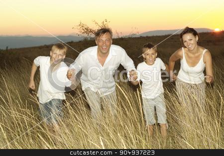 Happy family in wheat field stock photo, Happy family in wheat summer field at sunset by Ruslan Huzau
