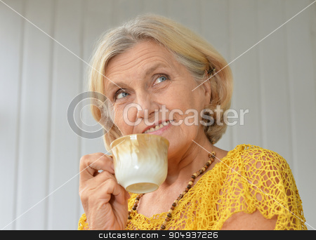 senior woman with cup of coffee stock photo, Portrait of senior woman with cup of coffee by Ruslan Huzau
