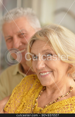 Happy senior couple   stock photo, Portrait of a happy senior couple at home by Ruslan Huzau