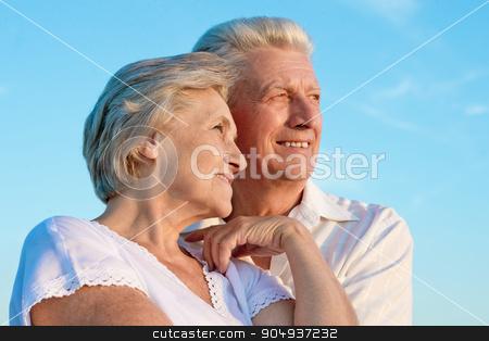elderly couple  on the background of sky stock photo, beautiful elderly couple  on the background of sky by Ruslan Huzau