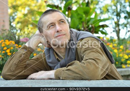 Happy man in park  stock photo, Happy man in park with flowers background by Ruslan Huzau