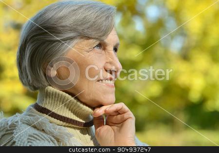 Happy elderly woman  stock photo, Happy elderly woman enjoying in autumn park by Ruslan Huzau