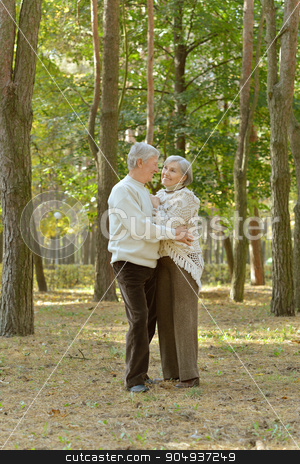 Senior couple resting  stock photo, Portrait of a senior couple resting in autumn park by Ruslan Huzau
