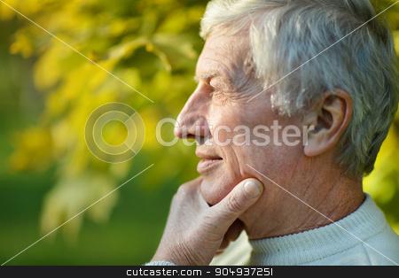 thoughtful elderly man stock photo, Portrait of thoughtful elderly man in autumn by Ruslan Huzau
