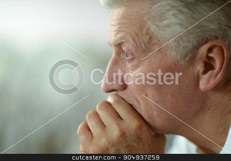 man at home stock photo, Portrait of a sad senior man at home by Ruslan Huzau