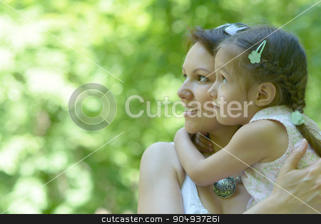 Little  girl with  mother in  park stock photo, Little cute girl with her mother in summer park by Ruslan Huzau