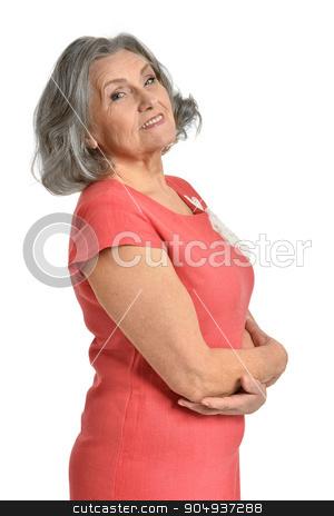 senior woman in bright dress stock photo, Portrait of senior woman in bright dress on white background by Ruslan Huzau