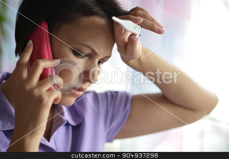 Sick woman calling to the doctor stock photo, Close-up portrait of an young ,sick woman calling to the doctor by Ruslan Huzau