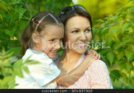girl with mother in park stock photo, Little cute girl with mother in park by Ruslan Huzau