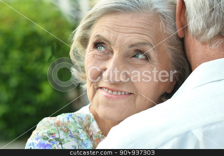 mature couple on  in summer park stock photo, Loving mature couple  in a summer park by Ruslan Huzau