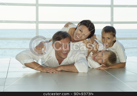 Happy family on ship stock photo, Portrait of a happy family on ship in summer by Ruslan Huzau