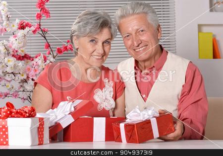 Mature couple celebrating new year stock photo, Happy beautiful elderly couple celebrating new year at home by Ruslan Huzau