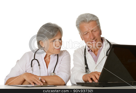 Thoughtful senior doctors sitting  with laptop stock photo, Thoughtful senior doctors sitting at table with laptop by Ruslan Huzau