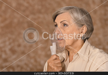 Senior woman making inhalation stock photo, Portrait of a senior woman making inhalation by Ruslan Huzau