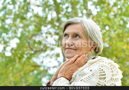 senior woman in  autumn park stock photo, Happy beautiful senior woman in the autumn park by Ruslan Huzau