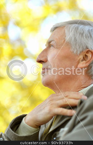 thoughtful elderly man stock photo, Portrait of thoughtful elderly man on yellow autumn background by Ruslan Huzau