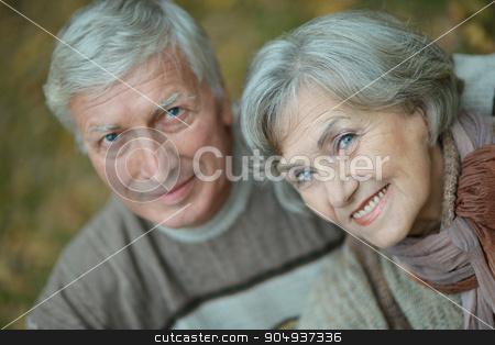 Happy senior couple  stock photo, Portrait of a happy senior couple in autumn park by Ruslan Huzau