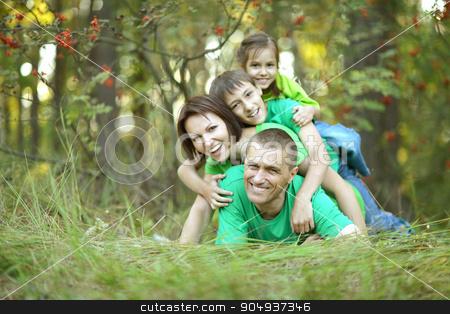 Family resting in  summer park stock photo, Happy Family resting in a summer park by Ruslan Huzau