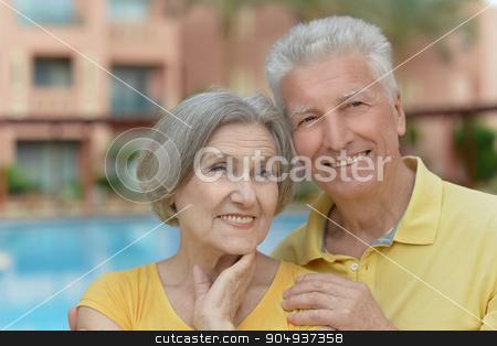 couple  on street stock photo, Portrait of a mature couple near wall on street by Ruslan Huzau