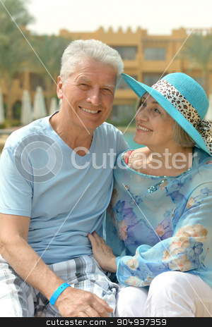Senior couple near hotel stock photo, Portrait of a senior couple relaxing near  hotel resort by Ruslan Huzau