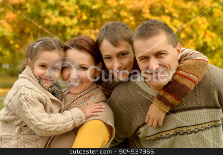 Happy family in autumn forest stock photo, Happy smiling family relaxing in autumn forest by Ruslan Huzau