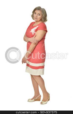 Portrait of senior woman stock photo, Portrait of senior woman in red dress on white background by Ruslan Huzau