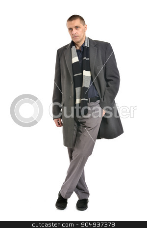Confident man posing  stock photo, Confident man posing in coat on a white background by Ruslan Huzau