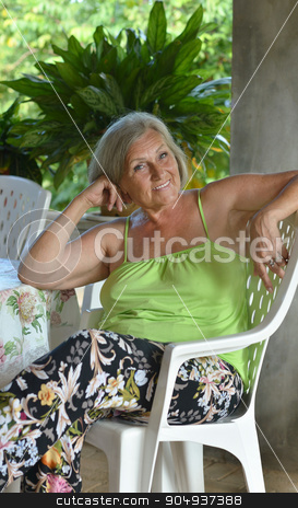 Older woman resting at tropical resort stock photo, Beautiful Older woman resting at tropical resort by Ruslan Huzau