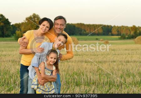 Happy family in wheat field stock photo, Happy family in wheat field in sunny day by Ruslan Huzau