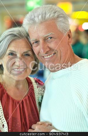 senior couple in  shopping center stock photo, Beautiful senior couple in a shopping center by Ruslan Huzau