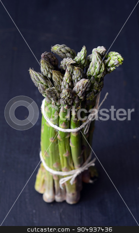 Fresh green asparagus stock photo, Bunch of fresh green asparagus spears on the table by sutike