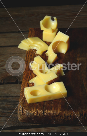 emmental cheese stock photo, pieces and slices of fresh emmental cheese by sutike