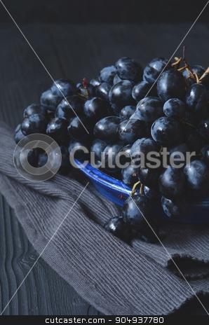 ripe dark grapes stock photo, Tasty ripe and sweet dark grapes over dark background by sutike