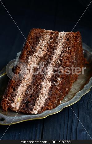 Dark chocolate cake stock photo,  Dark chocolate cake on a wooden table by sutike