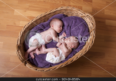 Newborn twins stock photo, Little newborn twins are sleeping. by HalfPoint