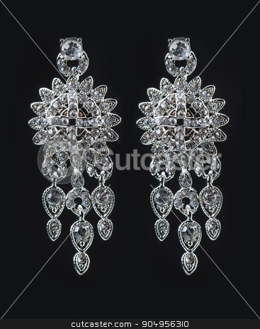 earrings with jewels on the black stock photo, Silver earrings with jewels on the black by Kopytin Georgy