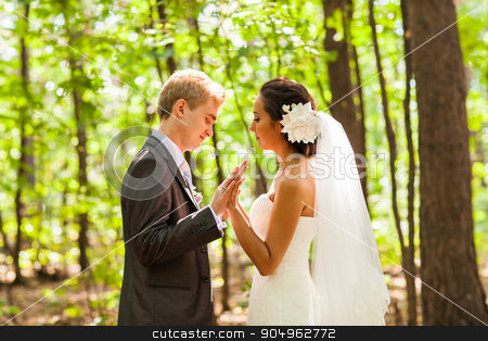 Bride and groom on a romantic moment stock photo, Bride and groom on a romantic moment by Satura86