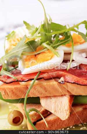 Turkey and bacon sandwich stock photo, Turkey and bacon sandwich with boiled egg on top by Digifoodstock