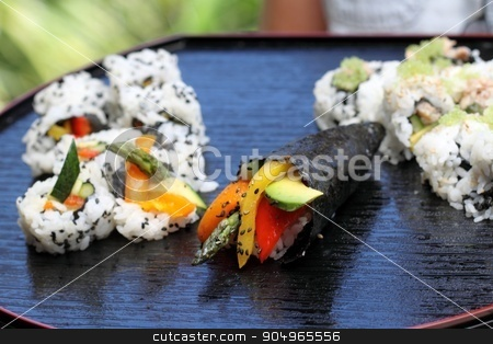 Sushi California Roll stock photo, Healthy very popular Japanese food sushi california roll. by Henrik Lehnerer