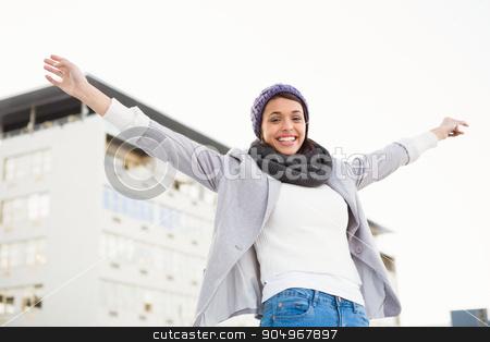 Happy woman raising her hands up  stock photo, Happy woman raising her hands up outside by Wavebreak Media