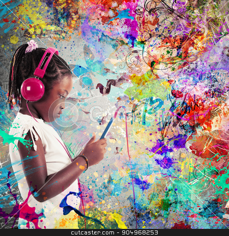 Passion for music stock photo, Little girl listening to music with headphones by Federico Caputo