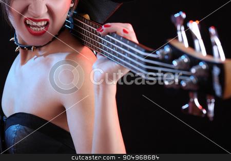 Fashion girl with guitar playing rock stock photo, Fashion sexy girl with guitar bass playing rock by Kopytin Georgy