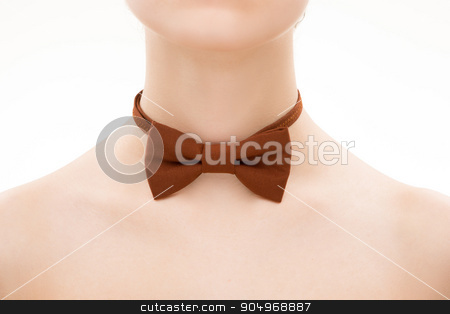 brown tie bow on female neck stock photo, brown tie bow on female neck. White background by Kopytin Georgy