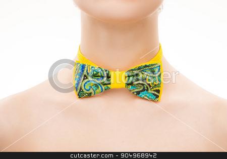 patterned tie bow on female neck stock photo, patterned tie bow on female neck. White background by Kopytin Georgy