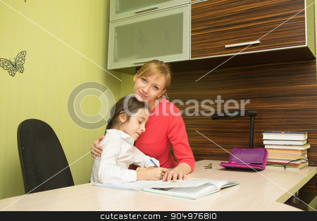 Beautiful school girl doing homework with sexy mother at home stock photo, Beautiful school girl doing homework with mother at home by Kopytin Georgy
