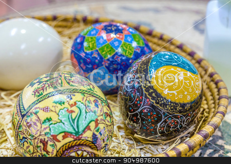 Easter painted eggs stock photo, The eggs are covered with fine mosaics on biblical themes, are in the basket by Sid10