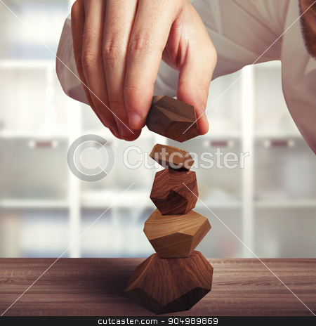 Tumi-ishi stock photo, Toy construction of different blocks of wood by Federico Caputo