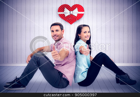 Composite image of  smiling couple sitting showing thumbs up  stock photo,  Smiling couple sitting showing thumbs up  against grey room Smiling couple sitting showing thumbs up on white background by Wavebreak Media