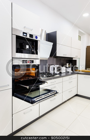 Modern hi-tek kitchen, oven with door open stock photo, Modern luxury hi-tek black and white kitchen, clean interior design, focu at oven with door open by Serghei Starus