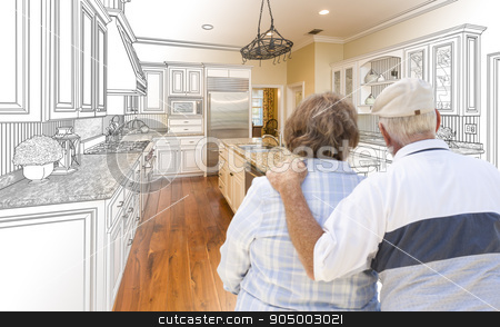 Senior Couple Looking Over Custom Kitchen Design Drawing and Pho stock photo, Senior Couple Looking Over Custom Kitchen Design Drawing and Photo Combination. by Andy Dean